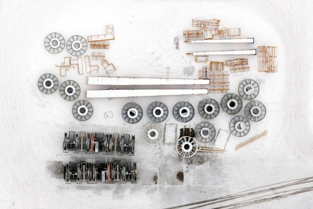 Kacper Kowalski new book Side Effects:  A snow covered industrial site at the port of Gdynia.