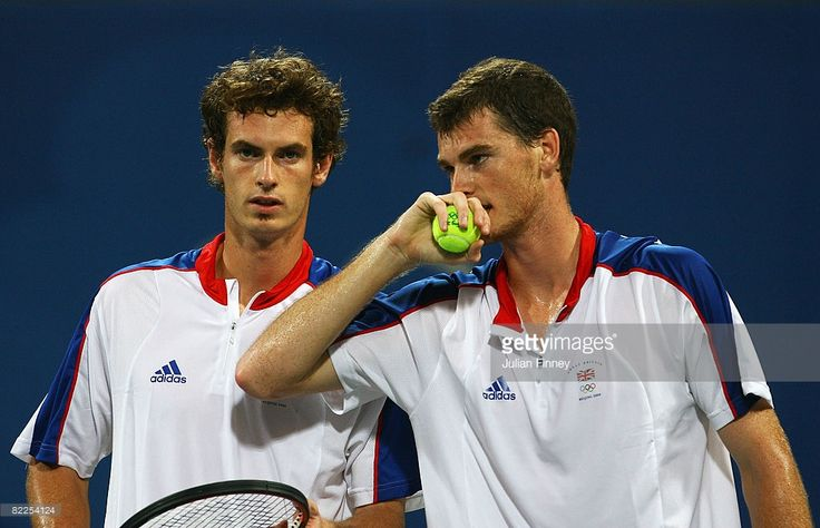 Andy Murray (L) of Great Britain looks on with his brother Jamie Murray in their Men's Doubles First Round match against Daniel Nestor and Frederic Niemeyer of Canada at the Olympic Green Tennis Center on Day 3 of the Beijing 2008 Olympic Games on August 11, 2008 in Beijing, China.