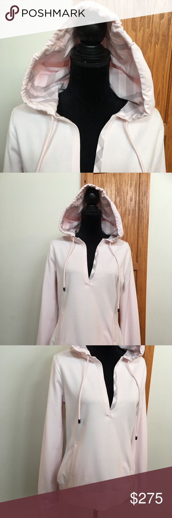 Burberry Brit Hooded Cotton Sweatshirt This is a brand-new Burberry Brit pink, white, and gray hooded sweatshirt. Hood is fully lined in the pink white and gray Burberry plaid. Absolutely gorgeous! V-neck front. This style is retired and no longer made by Burberry. ladies size large. No trades please. Burberry Tops Sweatshirts & Hoodies
