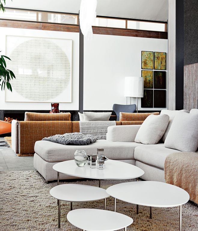 Two Sets Of Custom Ccile Boyds Sectional Sofas Demarcate Sitting Areas In The Living Room Eclipse Nesting Tables By Stua Sit Atop A Cream Colo