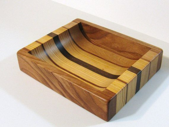 This is a Dresser Top Valet that I made from Cherry, Walnut and Western Cedar hardwoods.    The inside is rounded on the front and rear so it is easy to remove small items like change. The tray is finished with a clear satin environmentally safe finish.    The tray measures 6 1/2 by 8 by 1 5/8.    The tray is a great way to keep you furniture from getting scratched.    The tray has felt pads on the bottom and it is signed.    A great gift. My card is included.