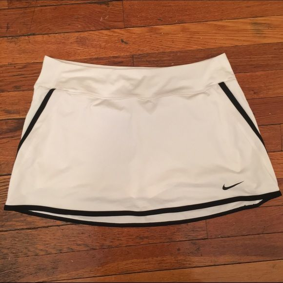 NWOT Nike Dri-Fit Tennis Golf Skort Sexy Fit Cute golf outfits are non-existent so when I started playing (as a result of my boyfriend's dedication to the sport) I went on a binge in search of the cutest attire I could find. Nike's dri-fit items not only keep you cool and hide the sweating, but the cuts are sassier than the overly modest women's golf wear designers. Nike Skirts