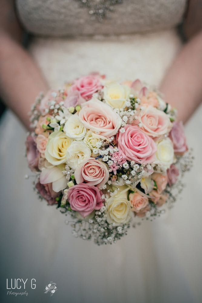 Pink and white bouquet with roses and gypsophila - Flowers by Laurel Weddings - Image by Lucy G Photography
