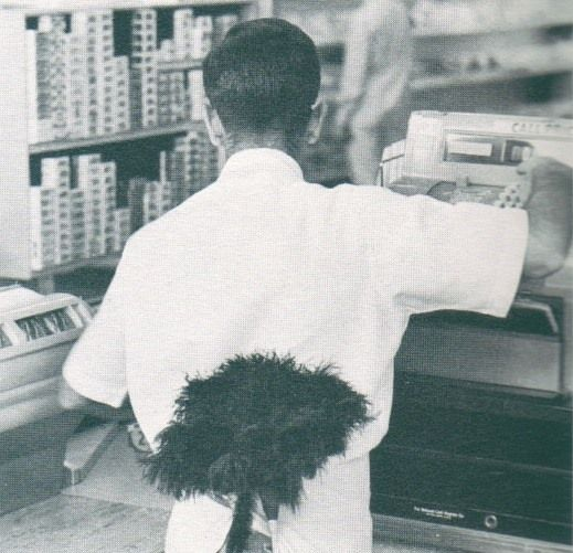 Lucky Stores late 1950s.  Duster has been surgically attached to employee.