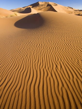 Rolling Orange Sand Dunes and Sand Ripples in the Erg Chebbi Sand Sea Near Merzouga, Morocco by Lee Frost.
