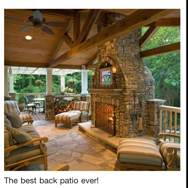 outdoor covered patio with a stone fireplace and niche for the tv an extension of your living space back porch so nice