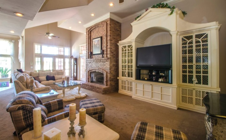 Lovely sitting room with flatscreen TV.  Listed by Jeff Biebuyck and Karen Baldwin. Photography courtesy of @Riley Jamison.