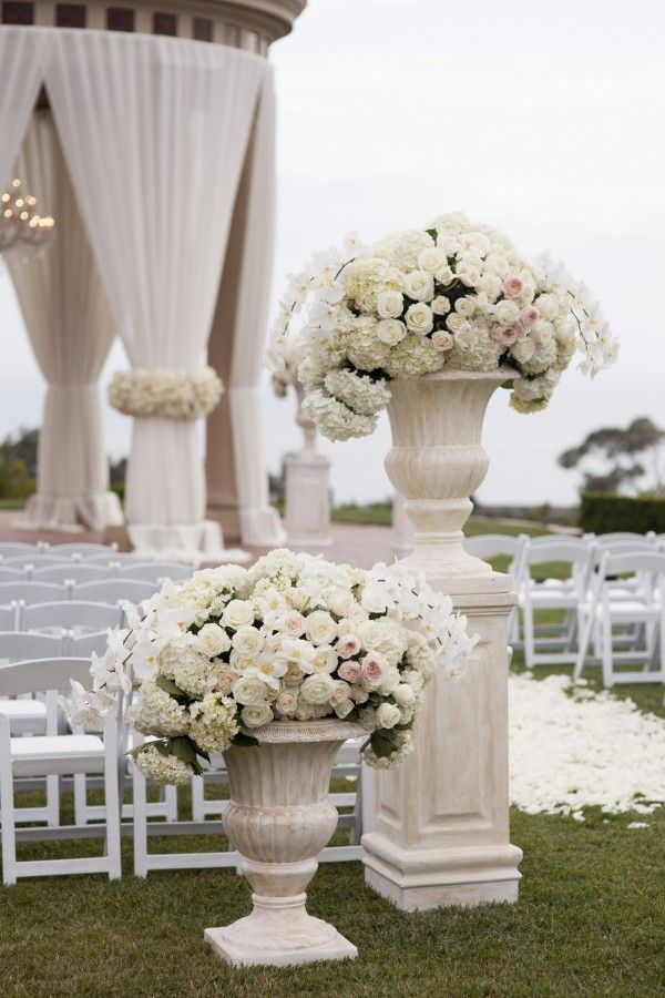 Orange County Wedding Planners Blog : Intertwined pelican hill wedding, white wedding, luxury wedding, classic wedding, timeless wedding, modern wedding, all white wedding, tall floral arrangements, wedding floral arrangements, all white flowers, elegant wedding, newport wedding, pelican hill, outdoor ceremony