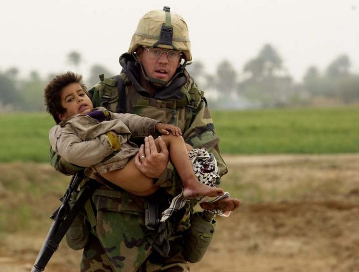 Soldier in photo dies after alleged PTSD struggle. During the first week of the war in Iraq, a Military Times photographer captured the arresting image of Army Spc. Joseph Patrick Dwyer as he raced through a battle zone clutching a tiny Iraqi boy named Ali. http://www.the-two-malcontents.com/2008/07/propaganda-soldier-in-photo-dies-after-alleged-ptsd-struggle/