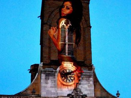 A 10 metre high semi-naked model projected onto the church tower at All Saints', Northampton