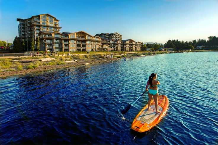 Stand-Up Paddling at Parksville Beach, just steps from The Beach Club Resort. #mypqb #pintowin #beachclubresort