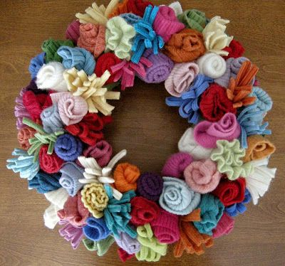 Beautiful wreath created from recycled sweaters by Betz White. Featured @totgreencrafts