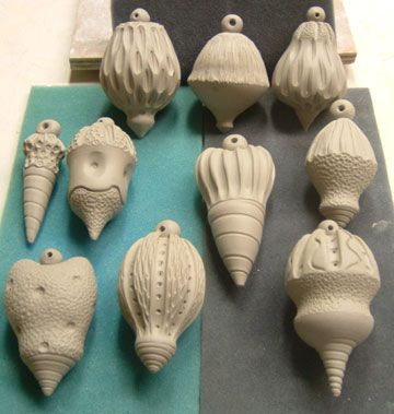 Wheelthrown Ornaments, ceramic, Love these, altered closed forms with a bead on top.#forms, #decorativetechnique