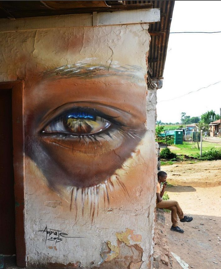 Matt  Adnate street art - painted in Soweto, a historic suburb in the city of Johannesburg, South Africa - Oct 2015