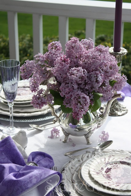 One of my faves: Lilacs, silver trays for chargers, silver teapot for a vase  a white cloth, candles in silver holders all served out on the veranda