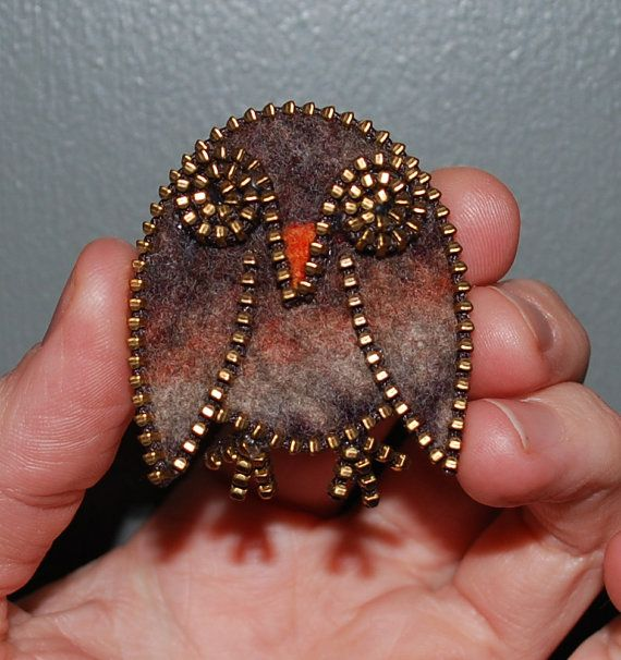 I designed and created this zipper brooch after finding the sweater shown in the 4th picture-doesnt it look like an owl? :)  I search for sweaters in thrift stores, then I shrink them down/felt them after multiple soapy hot washings. I then design a shape, cut it out, and outline it in zipper! Subtle bling!!! This listing is for one owl brooch- each one is uniquely beautiful in its exact pattern, they all are equally made with love and care!  The sweater I used to create the owl is shown…