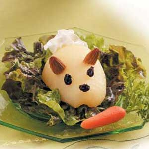 Bunny Pear Salad Recipe.  Red lettuce leaves, pear halves, dried currants or raisins, whole almonds, baby carrots, parsley sprigs, whipped cream in a can.