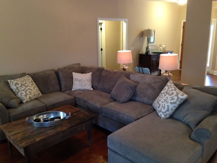 Haverty S Mineral Gray Sectional And Cream And Gray Pillows With Reclaimed Barn Wood Coffee Table Pottery Barn Quot Mr And Mrs Quot Pil Canary