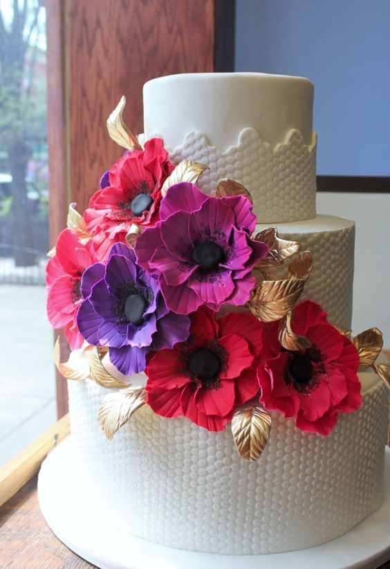 Romantic pink, red and purple flower wedding cake with gold leaf detail; Featured Cake: Alliance Bakery