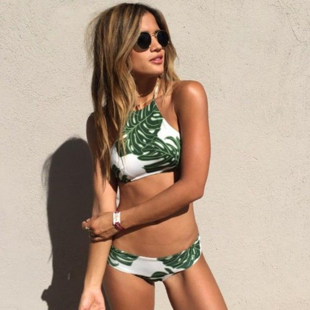 Wheretoget - White halter-neck bikini with green leaves print, and black round sunglasses