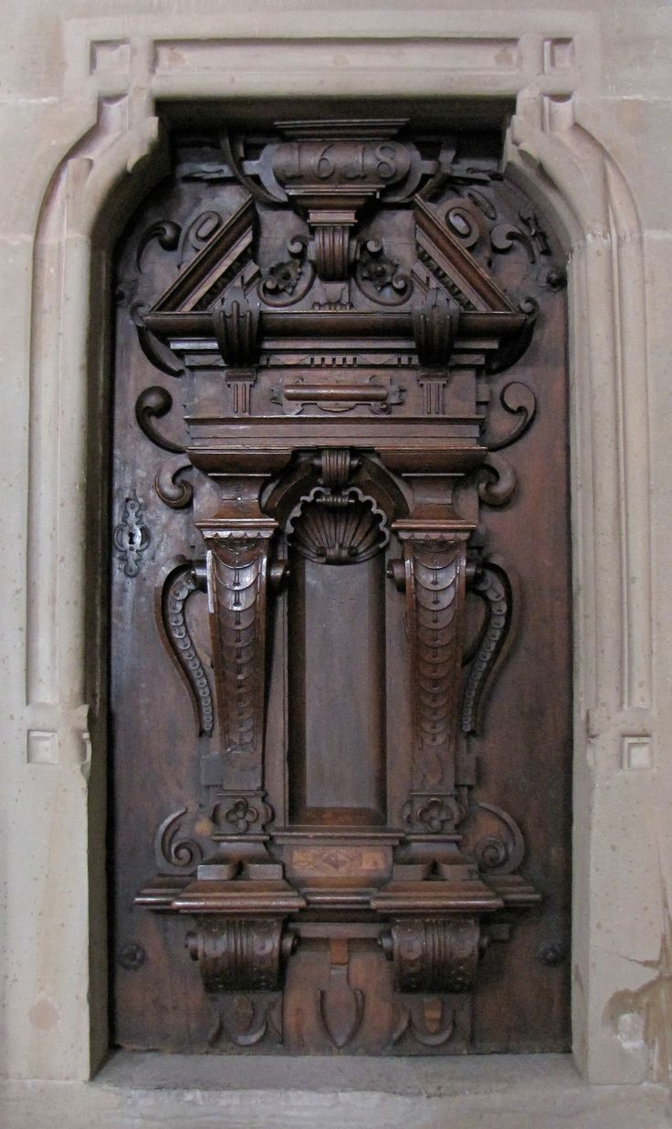 Small carved wood door in a Jesuit church, France, dating to the Renaissance