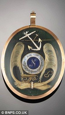 """Lord Nelson and Emma Hamilton love token.   This is a 3"""" gold locket decorated with pearls and containing locks of hair purportedly belonging both to Admiral Nelson and Emma Hamilton, his future lover, made shortly after Nelson's illustrious victory over Napoleon's fleet at the Nile on August 1, 1798."""