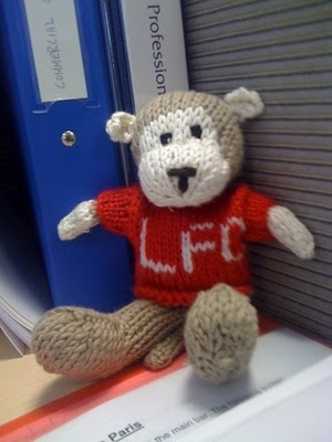 For his bookself Knitted monkey for Liverpool Football Club fan