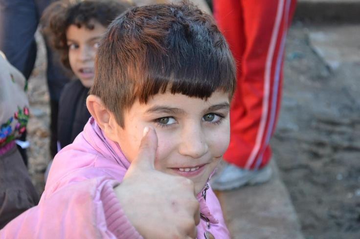 """Fotografia mea preferata din campania ShoeBox 2012 - pur si simplu ma fascineaza gestul acestui baietel. cat de multumit e cu ce are, cu ce primeste. Nu se vede lipsit, sarac, in afara societatii... el zambeste, arata ca """"totul e OK"""" si optimismul lui e molipsitor.    Cat de mult am putea sa invatam din atitudinea lui fata de viata..."""