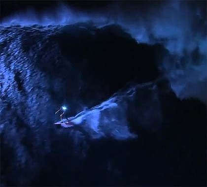 big wave surfing, at night. eff me sideways!