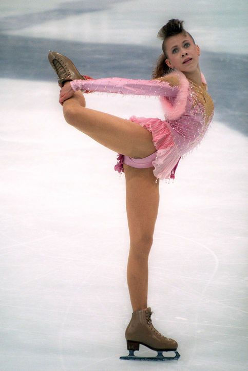 Best Olympic Ice Skating Costume: Oksana Baiul, 1994 If you're going to win the gold, don't you want to do it wearing a bedazzled, bubble-gum-pink dress with a micro-pleated skirt?
