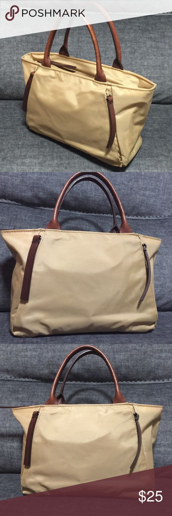 Banana Republic Tan Mini Tote Bag Nylon material mini tote bag. Brow leather strap handle and zipper tabs. Front and inside pockets included. Used excellent condition. Banana Republic Bags Totes