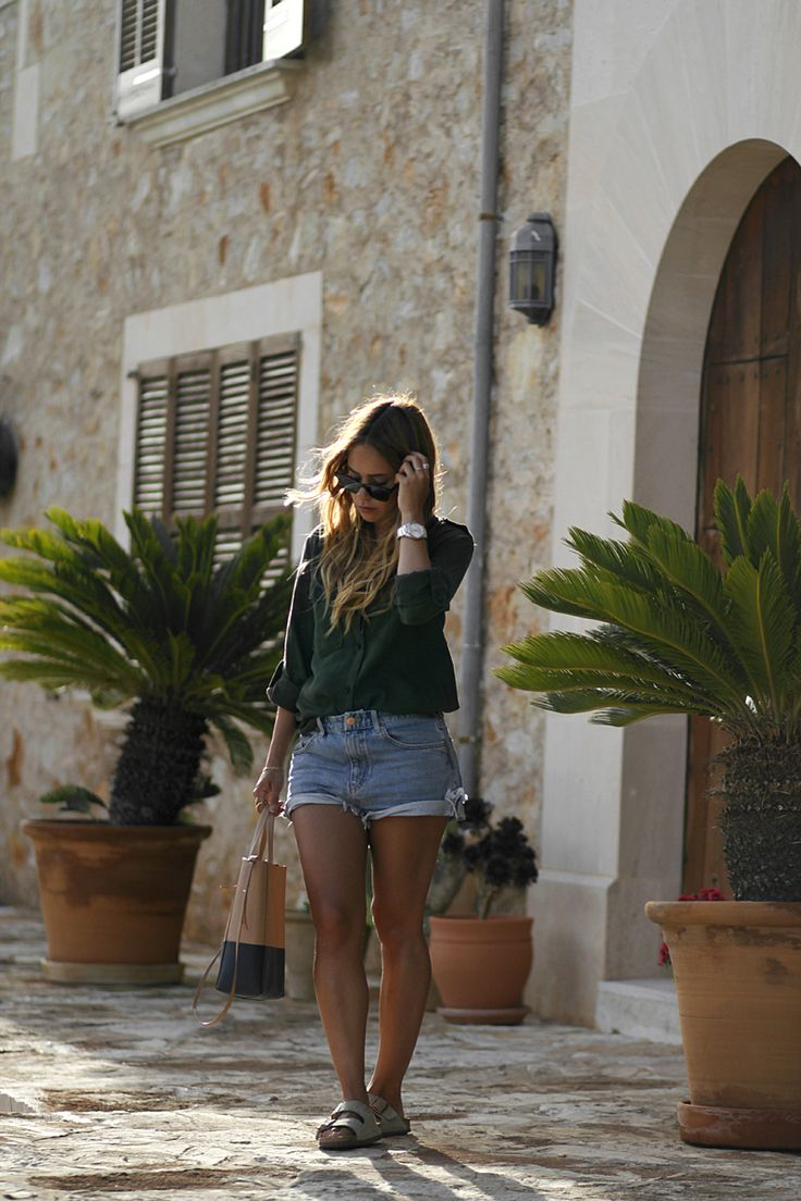 Outfit: The Safari Shirt in Mallorca. Desi is wearing: Military shirt – Zara. Denim Shorts – Mih Jeans. Lace bra – Mango. Tote bag – Céline. Sunglasses – Dior Homme. Sandals – Birkenstocks. - teetharejade.com