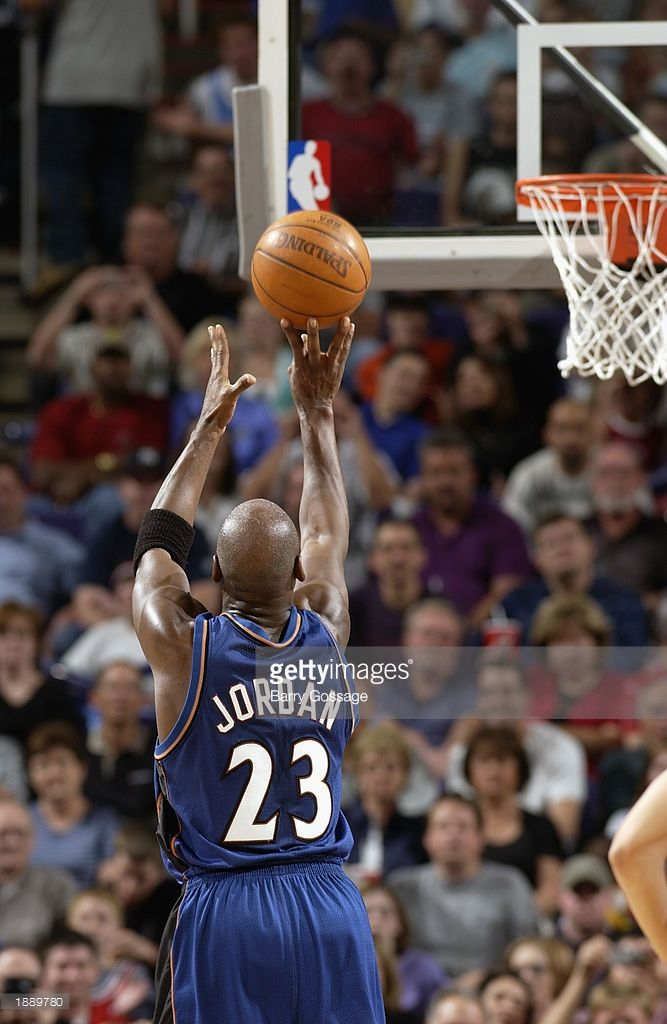 Michael Jordan #23 of the Washington Wizards shoots a free throw against the Phoenix Suns during the game at America West Arena on March 21, 2003 in Phoenix, Arizona. The Suns won 109-83.