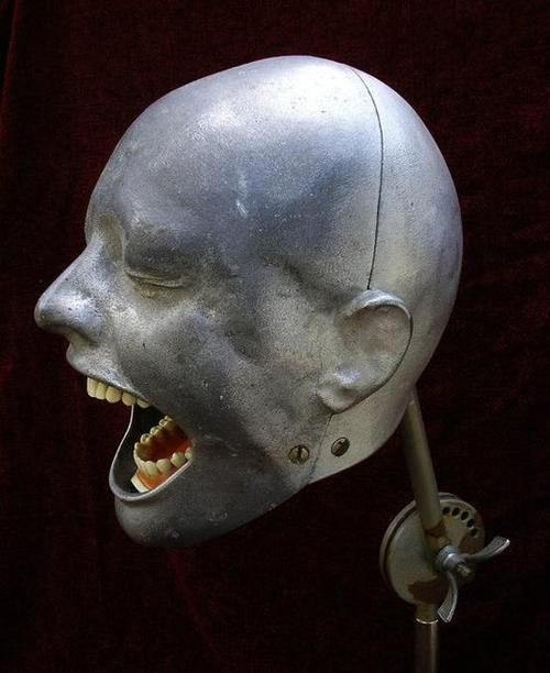 Dental teaching head - appropriate , considering that's how most people look at the dentist. Like they're in immense pain.
