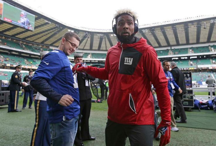 Giants vs. Rams in London:     October 23, 2016  -   17-10, Giants  -  New York Giants wide receiver Odell Beckham (13) signs an autograph after warmups before an NFL football game between the New York Giants and the Los Angeles Rams at Twickenham Stadium in London, Sunday Oct. 23, 2016.