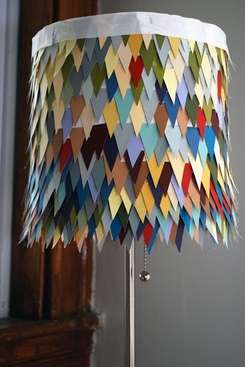 love the idea (paint chip lamp shade)...although I would give the top a better treatment. Great colors, though.