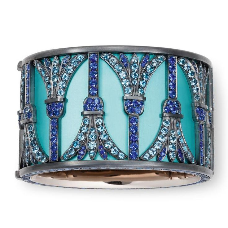 Hemmerle of Munich will showcase this pharaonic-style bangle in aluminium, silver and white gold featuring aquamarines and sapphires.