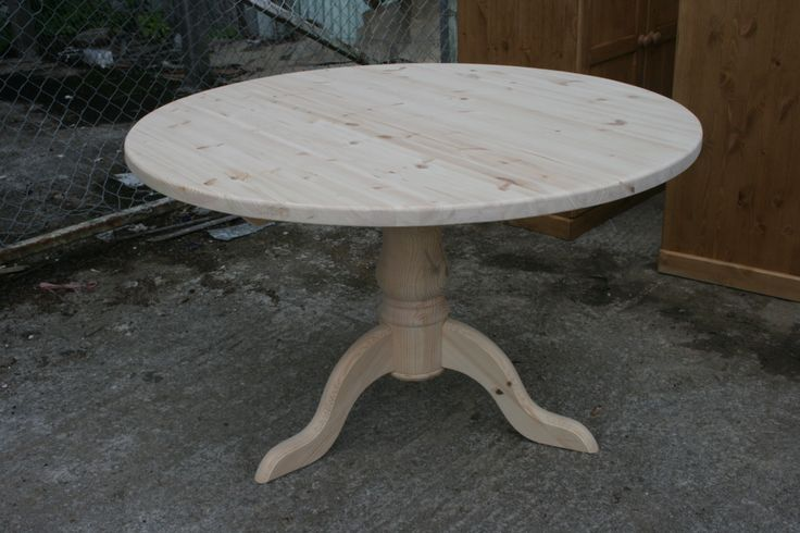Beautiful hand made round pine table: http://www.pinefarmhousetable.co.uk/