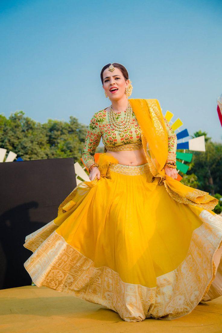 Yellow mehendi lehengA by Anju modi