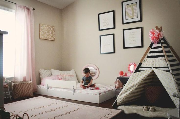 toddler bed on the floor. Use a trundle bed frame and take the wheels off. I like this idea!