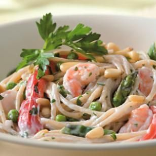 Creamy Garlic Pasta with Shrimp & Vegetables Recipe for Two  | Toss a garlicky, Middle Eastern-inspired yogurt sauce with pasta, shrimp, asparagus, peas and red bell pepper for a fresh, satisfying summer meal.