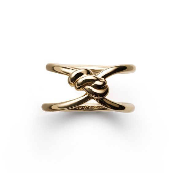 PACKAGING: idea for a bottle's neck jewel: gold knot ring by Nora Kogan.