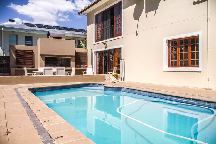 If you were to take a gander through the large glass door, you not only can see the beautiful view of the valley but you also experience the manicured garden and outside entertainment area with outside braai and swimming pool.