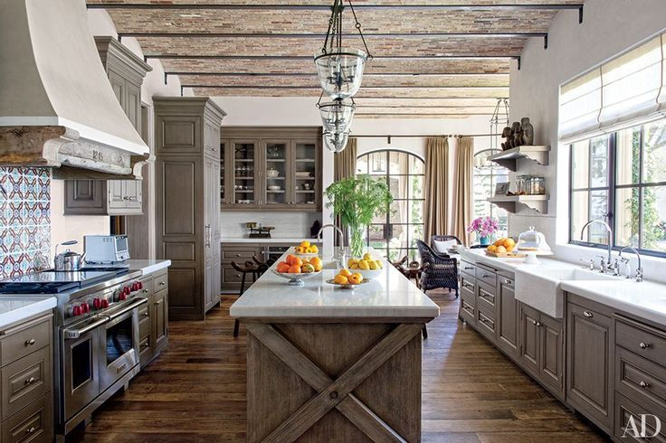 kitchen with exposed wood cabinets surrounding gourmet range and farmhouse sink