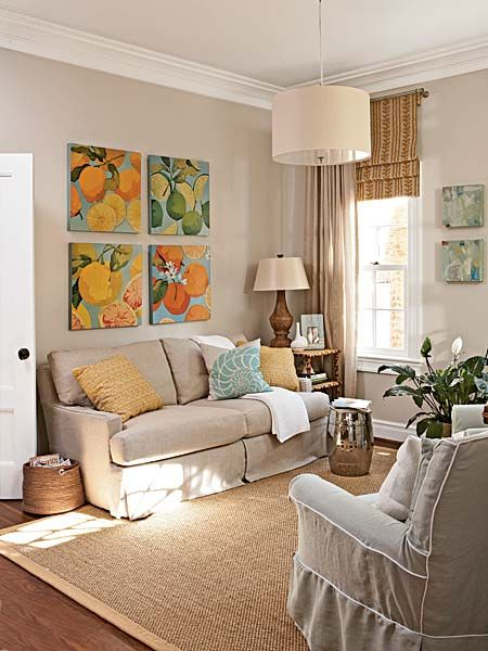 Small living room. Neutral walls & furniture, bright art and accessories.