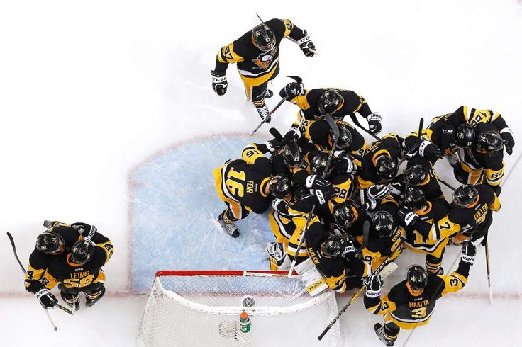 Penguins celebrate their win:    The Pittsburgh Penguins celebrate after defeating the Tampa Bay Lightning in Game Seven of the Eastern Conference Final with a score of 2 to 1 during the 2016 NHL Stanley Cup Playoffs at Consol Energy Center on May 26, in Pittsburgh, Penn.