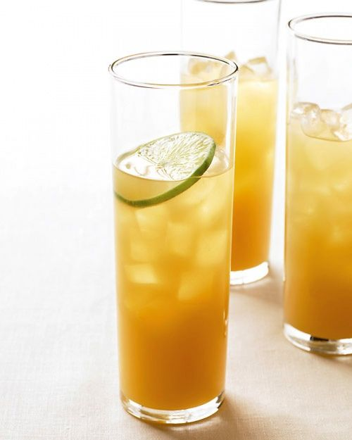 1 can (46 ounces) pineapple juice  2 cups spiced rum  1/2 cup fresh lime juice (from 6 to 8 limes)  Lime slices, for garnish