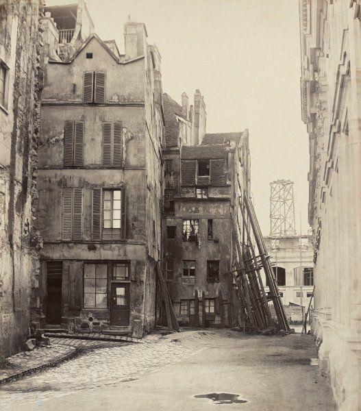 Marville: Rue du Marché aux Fleurs, du quai Desaix. Île de la Cité. Paris IVe. 1865.