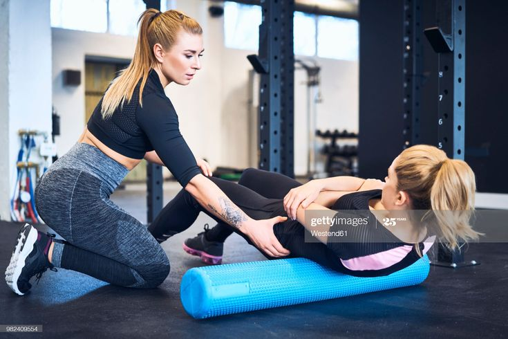 Woman Massages Muscles With Personal Trainer After Gym Workout Personal Fitness Trainer Personal Trainer Gym Workouts