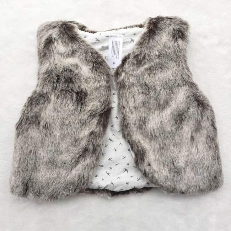 Faux fur vest for the dashing little lady! Printed silk lining with single button closure Available in Cream, Grey or Blush